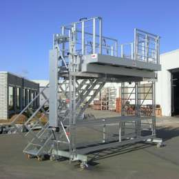 Height adjustable workplatform used to work on the production line of boat engines.